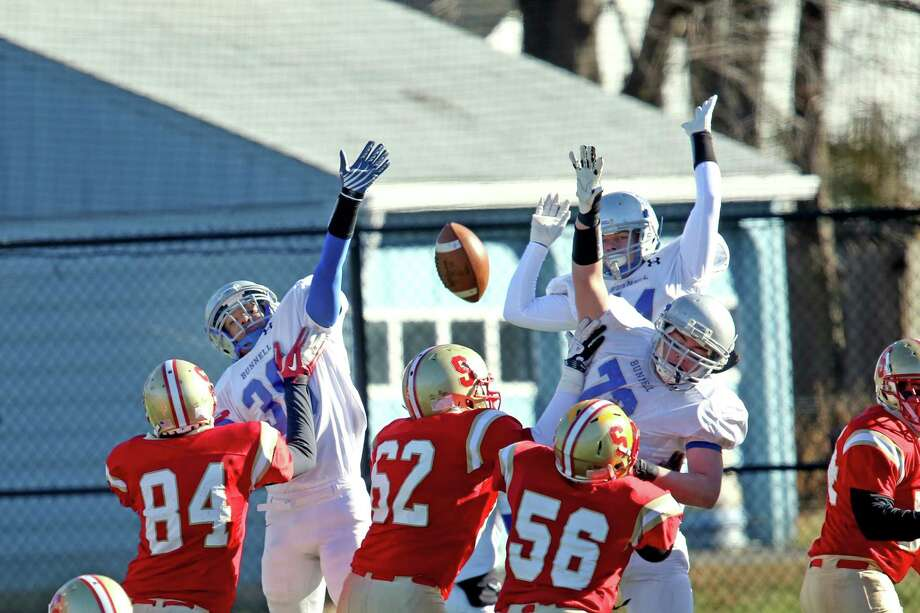 Bunnell High School's #38 (name not on rooster), #44 Cole Davis and #72 Benjamin Ruskin attempt to block the field goal on Stratford High School's special teams during first half action on Thursday Thanksgiving match-up. Bunnell would win 12-10. Photo: Mike Ross / Mike Ross Connecticut Post freelance - @www.mikerossphoto.com