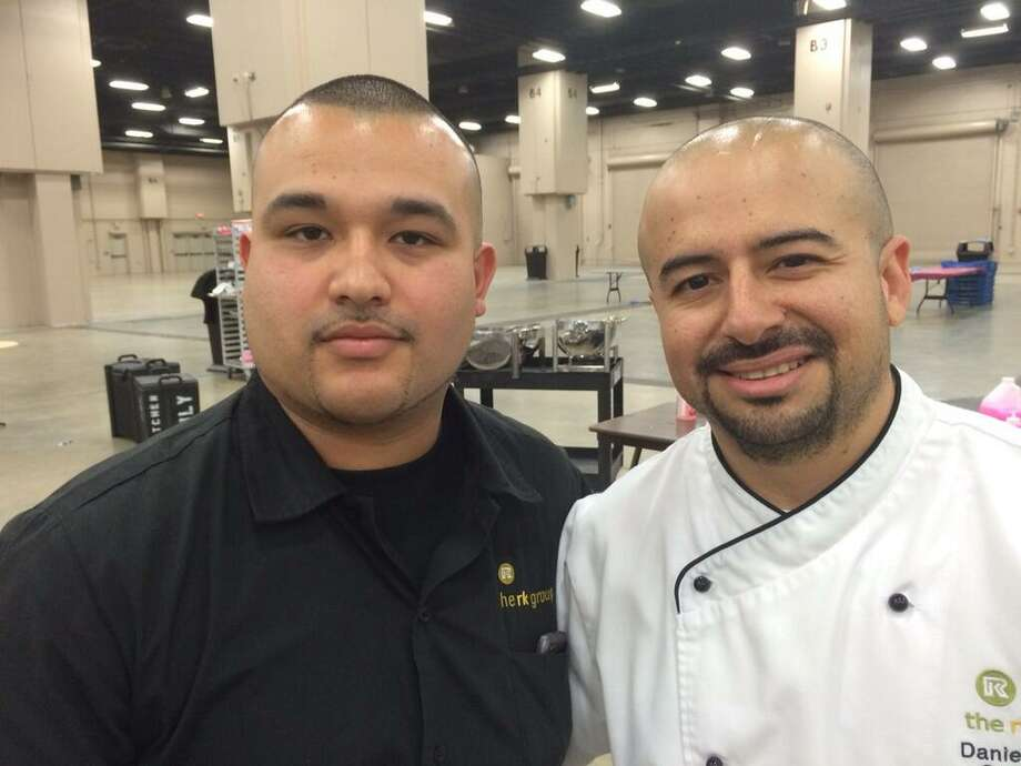 Assistant Manager Jacob Rodriguez and Chef Daniel Gomez with the RK Group behind the scenes at the Raul Jimenez Thanksgiving Dinner Thursday, Nov. 28, 2013. Photo: Vincent T. Davis / San Antonio Express-News