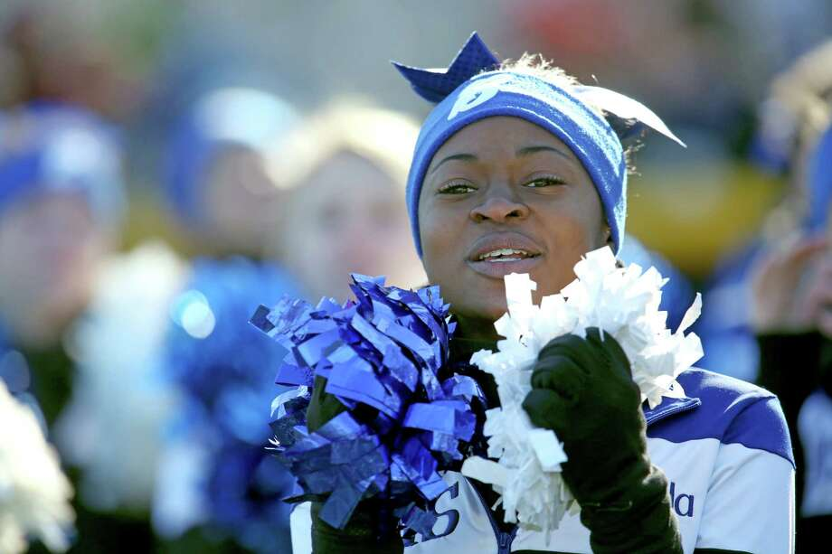 A Bunnell High School cheerleader performs during half time during Thursday's Thanksgiving match-up against Stratford High School and Bunnell High School. Photo: Mike Ross / Mike Ross Connecticut Post freelance - @www.mikerossphoto.com
