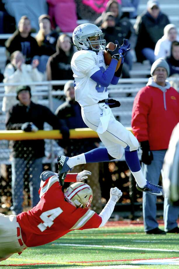 Bunnell High School's #80 Devante Teel completes a first down reception over Stratford High School's #4 Isaiah Brooker during Thursday Thanksgiving match-up. Bunnell would win 12-10. Photo: Mike Ross / Mike Ross Connecticut Post freelance - @www.mikerossphoto.com