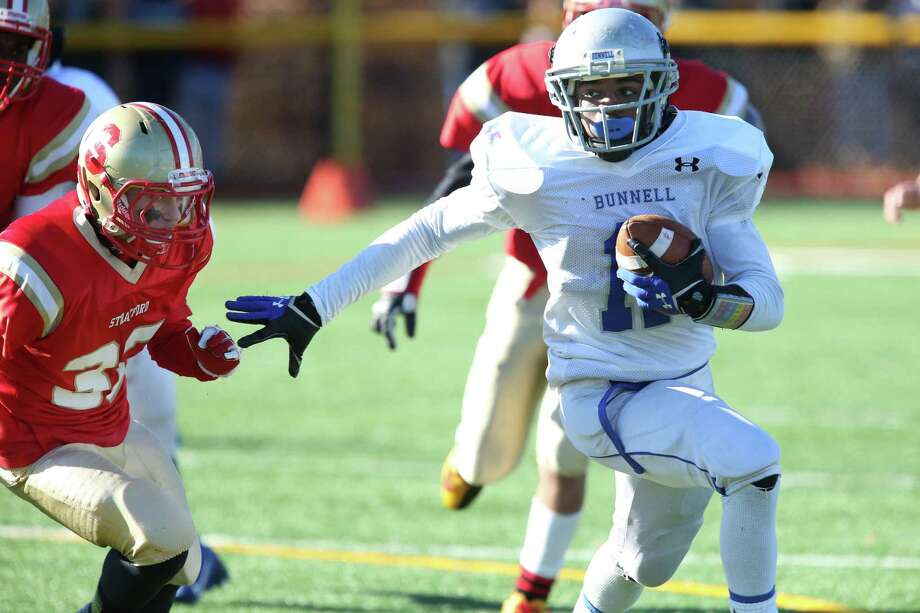 Bunnell High School's #11 Justin Townsend gain yardage during the second half action against Stratford High School at Thursday's Thanksgiving match-up. Bunnell would win 12-10. Photo: Mike Ross / Mike Ross Connecticut Post freelance - @www.mikerossphoto.com