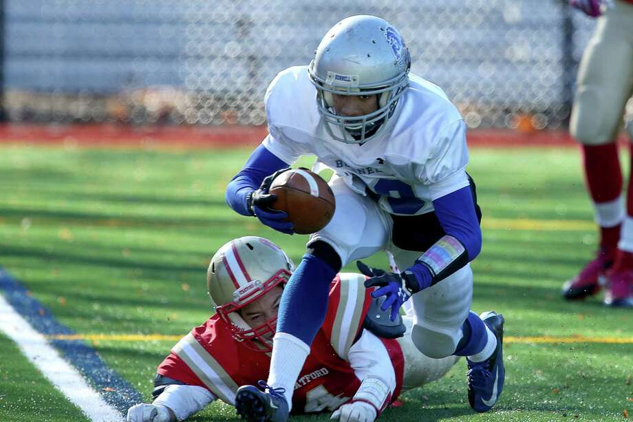Bunnell High School's #80 Devante Teel scores a touchdown over Stratford High School's #4 Isaiah Brooker during Thursday Thanksgiving match-up. Bunnell would win 12-10. Photo: Mike Ross / Mike Ross Connecticut Post freelance - @www.mikerossphoto.com