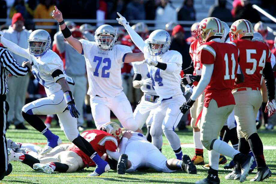 Bunnell High School's defense celebrate after teammate #74 Anthony Johnson recovers a fumble during the final minutes against Stratford High School on Thursday Thanksgiving match-up. Bunnell would win 12-10. Photo: Mike Ross / Mike Ross Connecticut Post freelance - @www.mikerossphoto.com