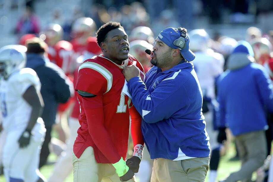 Bunnell High School's head coach Doug Cotto tries to break up a fight from opposing team player  #10 Marquess Daniels at the end of Thanksgiving match-up between Bunnell and Stratford High School. Bunnell would win 12-10. Photo: Mike Ross / Mike Ross Connecticut Post freelance - @www.mikerossphoto.com