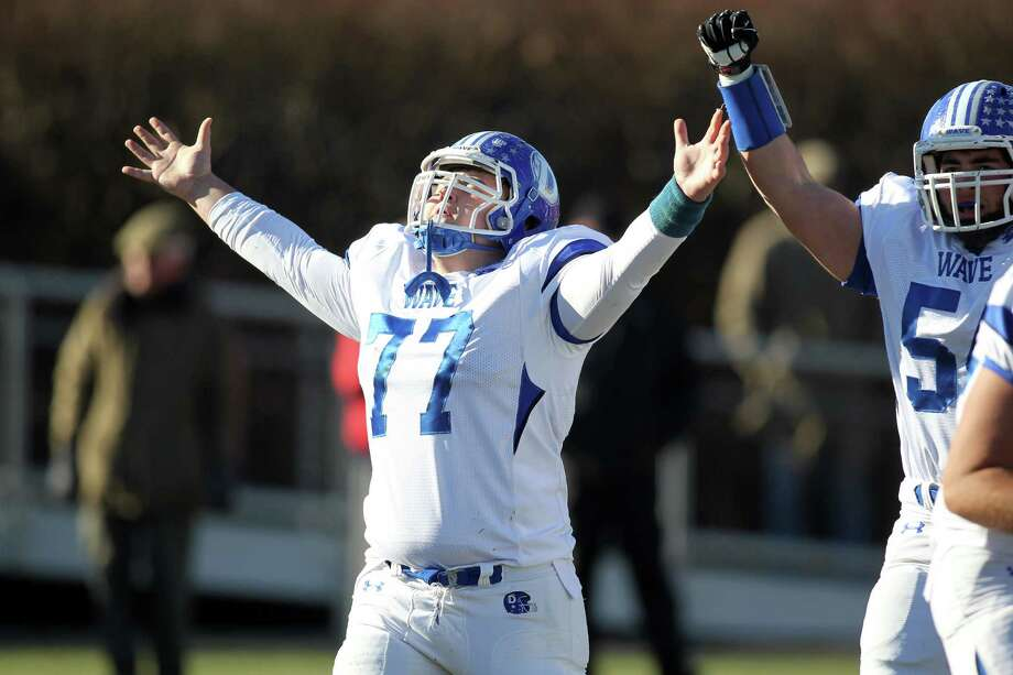 Darien center Alexander Gunn celebrates a Darien score that put them on top in the annual Turkey Bowl at New Canaan High School on Thursday afternoon. Darien won the see saw battle, 28-24. J. Gregory Raymond for The Advocate Photo: J. Gregory Raymond / Stamford Advocate Freelance;  © J. Gregory Raymond