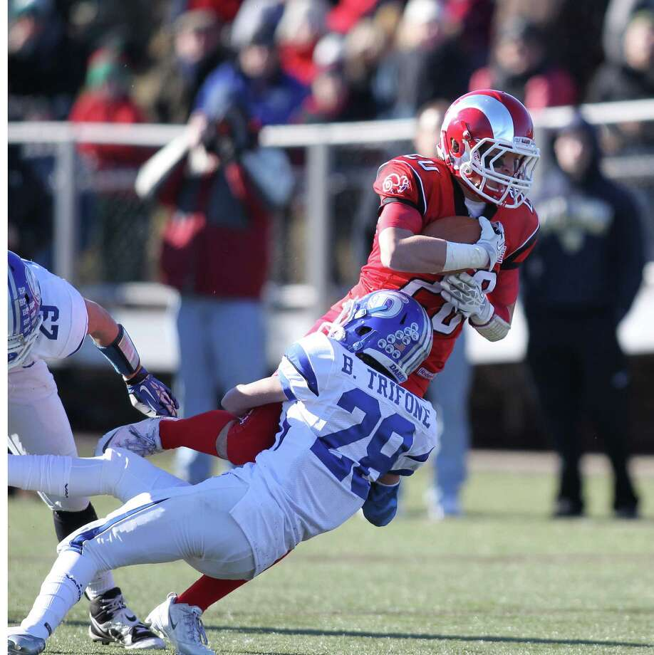 New Canaan wideout Kyle Smith is tackled by Bobby Trifone of Darien during first half action at Dunning Stadium in New Canaan. Darien won the see saw battle, 28-24. J. Gregory Raymond for The Advocate Photo: J. Gregory Raymond / Stamford Advocate Freelance;  © J. Gregory Raymond