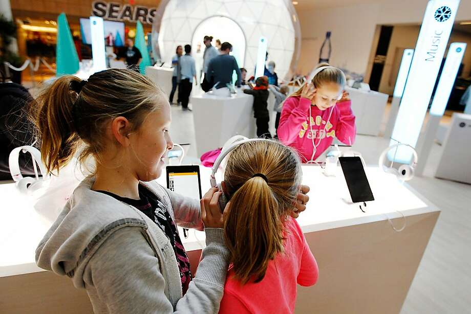 Tristen Hoffman (left), 9, listens to music on a Nexus 7 tablet with cousins Jadyn, 6, and Jordyn Hoffman, 10. Photo: Genevieve Ross, Special To The Chronicle