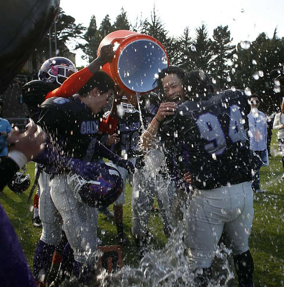 Galileo celebrates its 2013 win in the Turkey Day Game by dousing head coach Mark Huynh. The Lions defeated Lincoln's Mustangs 34-30 for their 17th San Francisco Section title. Photo: Lacy Atkins, The Chronicle