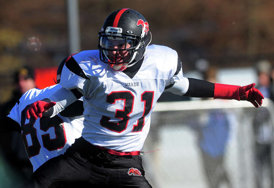 Fairfield Warde's T.J. Gallagher celebrates a touchdown, during Thanksgivig Day football action against cross-town rival Fairfield Ludlowe in Fairfield, Conn. on Thursday November 28, 2013. Photo: Christian Abraham / Connecticut Post