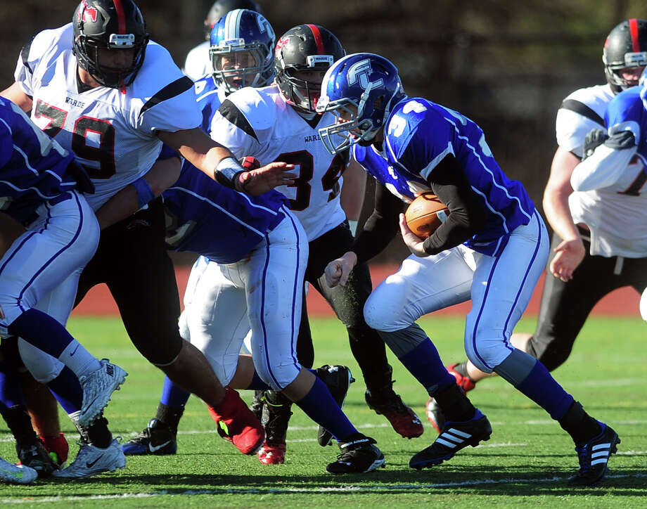 Fairfield Ludlowe's Jimmy Gasper carries the ball, during Thanksgivig Day football action against cross-town rival Fairfield Warde in Fairfield, Conn. on Thursday November 28, 2013. Photo: Christian Abraham / Connecticut Post