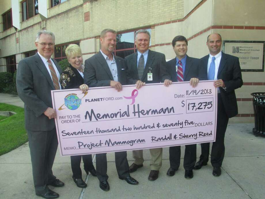 Planet Ford donated a portion of each car sold during October to the Northeast Hospital Foundation's Project Mammogram. Present at the ceremony are, from left, Chuck Kramer, Kristi Williams, Randall Reed, Norman Funderburk, Louis Smith and Heath Rushing. Photo: Memorial Hermann