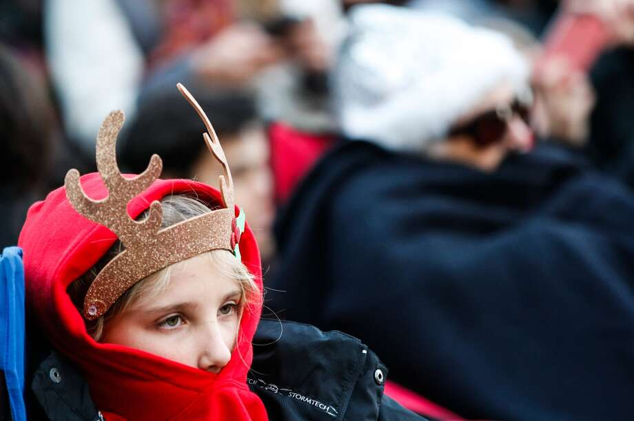 Maley Gleason said she is freezing as she awaited the lighting of the 80 trees at the Uptown Lighting in Houston on Thanskgiving Day, Nov. 28, 2013.  Photo: Johnny Hanson, Houston Chronicle
