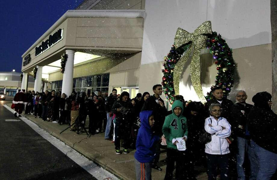 Shoppers line up outside a Palais Royal in the Meyerland shopping center on Thursday, Nov. 28, 2013, in Houston. Photo: J. Patric Schneider, For The Chronicle / © 2013 Houston Chronicle