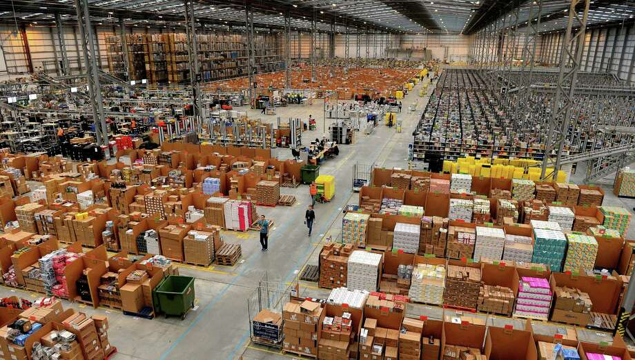 Online retail giant Amazon.com has warehouses across the world, including this one in Peterborough, central England. The online retail giant expects cyber Monday to be one of the busiest online shopping days of the year. Photo: Photos By Getty Images