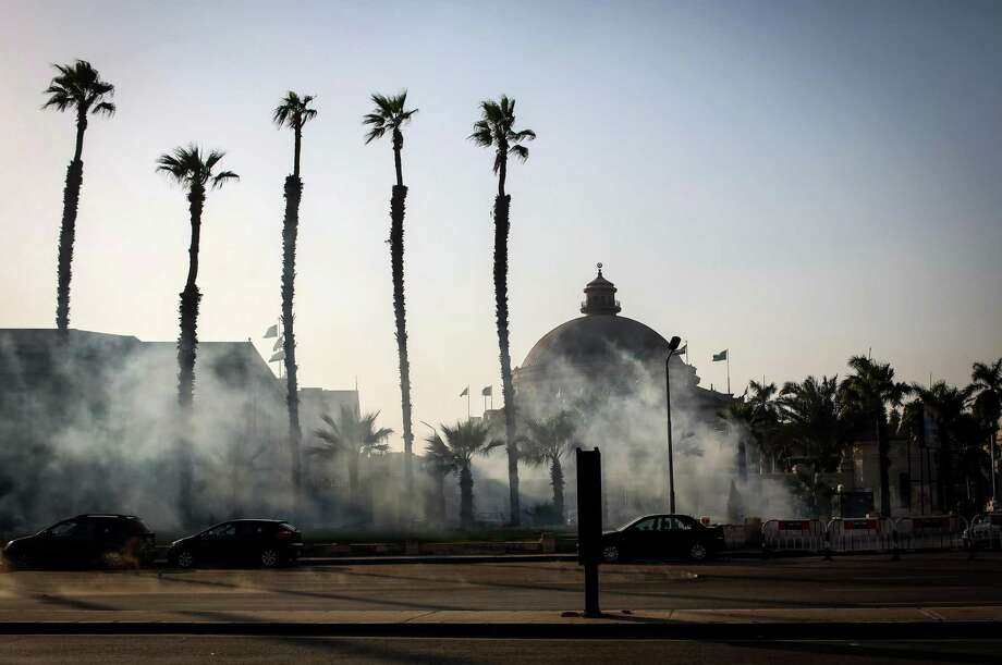 Tear gas fills the street as Egyptian protesters clash with security forces outside a Cairo university. Photo: Eman Helal / Associated Press