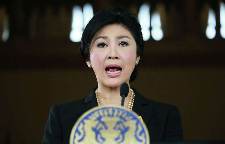 Thai Prime Minister Yingluck Shinawatra survived a no-confi- dence vote.