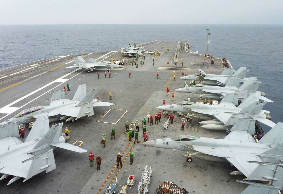 U.S. Navy FA-18 Hornets cram the flight deck of the USS George Washington during a joint military exercise with Japan near Okinawa. Photo: Kyodo News / Associated Press