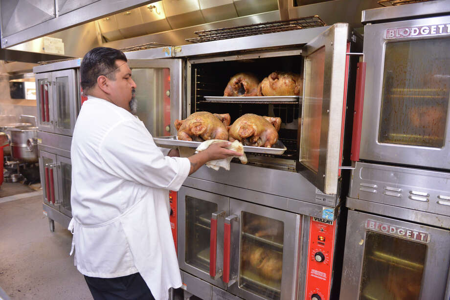 Chef Roy Orozco checks on some of the 500 turkey's be prepared Monday, Nov. 25, 2013, in the RK Group kitchens at the Henry B. Gonzalez Convention Center for the annual Raul Jimenez Thanksgiving Dinner. Photo: Robin Jerstad, For The San Antonio Express-News