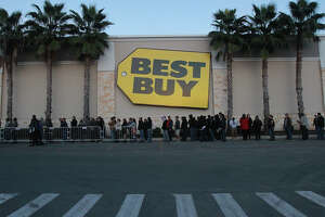 A long line snakes around the Best Buy store at the Rim shopping center on Thanksgiving Day Thursday November 28, 2013. The shopping frenzy on Thanksgiving night is known as Gray Thursday.