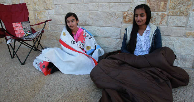 Rose Kaur,12, (left) and Muskaan Sarai,13, stay warm while waiting for the Best Buy store at the Rim to open Thanksgiving night Thursday November 28, 2013. Photo: JOHN DAVENPORT, San Antonio Express-News / ©San Antonio Express-News/Photo may be sold to the public