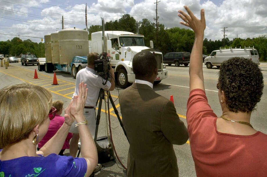 Dignitaries at the Savannah River Site in Aiken, S.C., applaud on May 8, 2001, as a tractor-trailer carrying the first shipment of radioactive waste leaves the former nuclear weapons plant. Photo: Associated Press File Photo