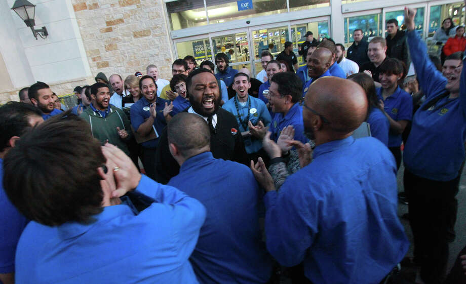 Geek Squad supervisor Miles Burton (center, mouth open with beard) gets Best Buy employees pepped up before the doors open at Best Buy at the Rim Thanksgiving night. Photo: JOHN DAVENPORT, San Antonio Express-News / ©San Antonio Express-News/Photo may be sold to the public