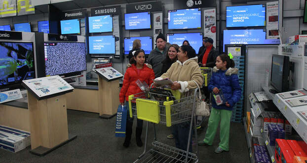 Shoppers look for products at Best Buy at the Rim Thursday Thanksgiving November 28, 2013. Photo: JOHN DAVENPORT, San Antonio Express-News / ©San Antonio Express-News/Photo may be sold to the public