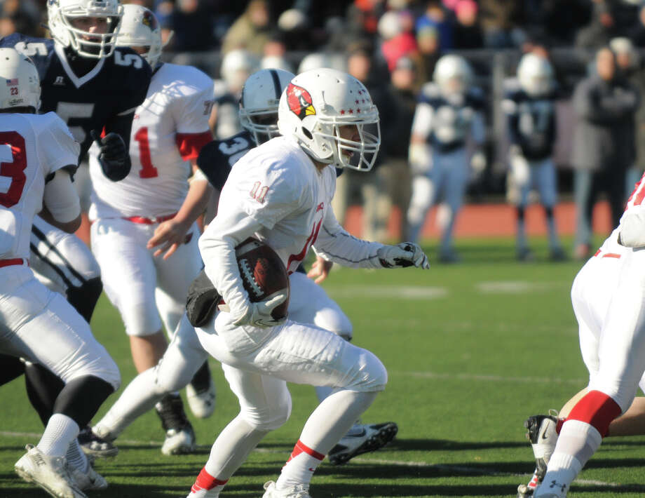 Greenwich's Ryan Pasquali moves the ball as Greenwich and Staples High Schools face off in a Thanksgiving Day football game at Staples in Westport, Conn., Nov. 28, 2013. Greenwich won the match, 27-7. Photo: Keelin Daly / Stamford Advocate Freelance