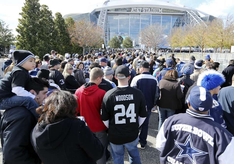 Football fans wait to enter AT&T Stadium before the Dallas Cowboys and Oakland Raiders game Thursday Nov. 28, 2013 in Arlington, Tx. Photo: Edward A. Ornelas, San Antonio Express-News