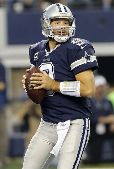 Dallas Cowboys' Tony Romo looks to pass against the  Oakland Raiders during first half action Thursd