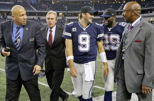 Dallas Cowboys' Tony Romo (center left) jokes with teammate DeMarco Murray after an interview after the game with the Oakland Raiders Thursday Nov. 28, 2013 at AT&T Stadium in Arlington, Tx. The Cowboys won 31-24. Photo: Edward A. Ornelas, San Antonio Express-News