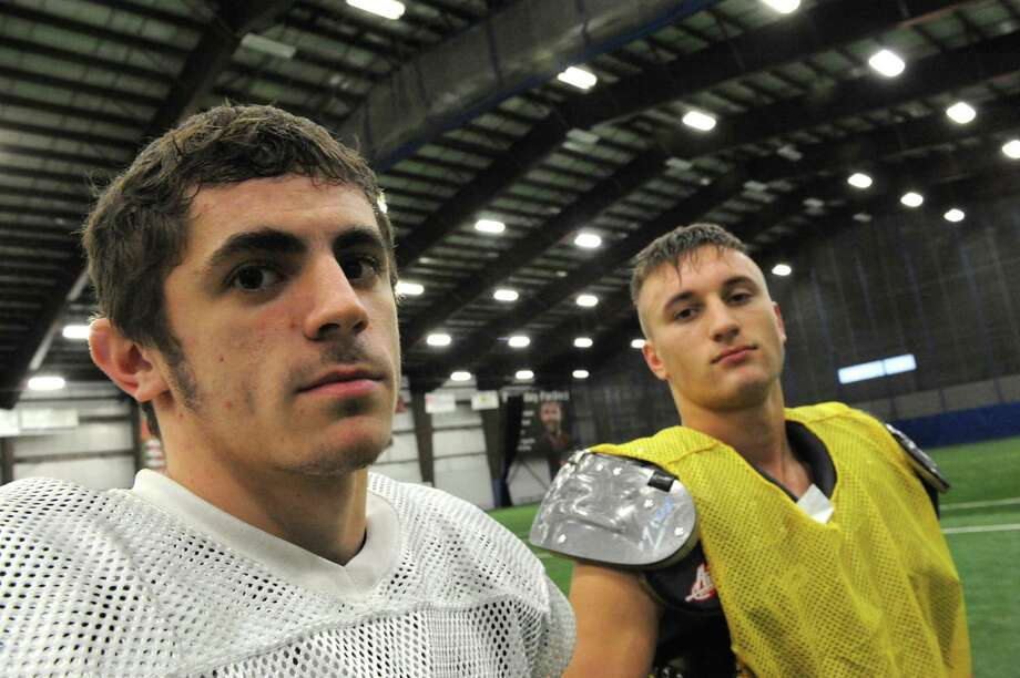Schalmont High School football receivers Hunter Gac, left, and Kyle Strube during practice at the Halfmoon Sportsplex  on Wednesday Nov. 27, 2013 in Halfmoon, N.Y. (Michael P. Farrell/Times Union) Photo: Michael P. Farrell / 00024827A