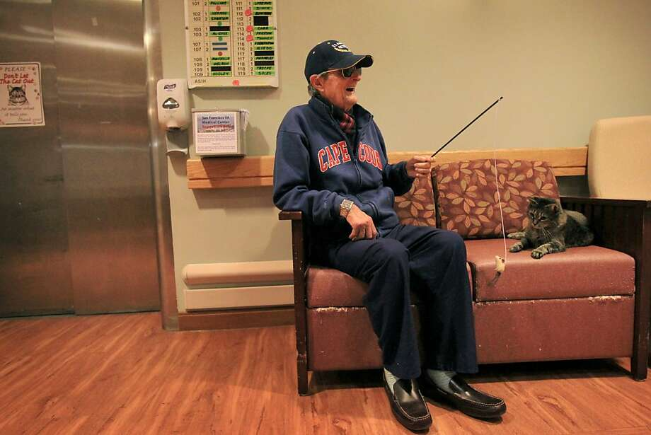 Clark Wood plays with Miley near the nurse's station in the Community Living Center at the VA Medical Center in S.F. Photo: Leah Millis, The Chronicle
