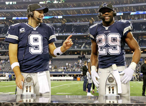 Dallas Cowboys' Tony Romo (left) jokes with teammate DeMarco Murray during an interview after the game with the Oakland Raiders Thursday Nov. 28, 2013 at AT&T Stadium in Arlington, Tx. The Cowboys won 31-24. Photo: Edward A. Ornelas, San Antonio Express-News / © 2013 San Antonio Express-News