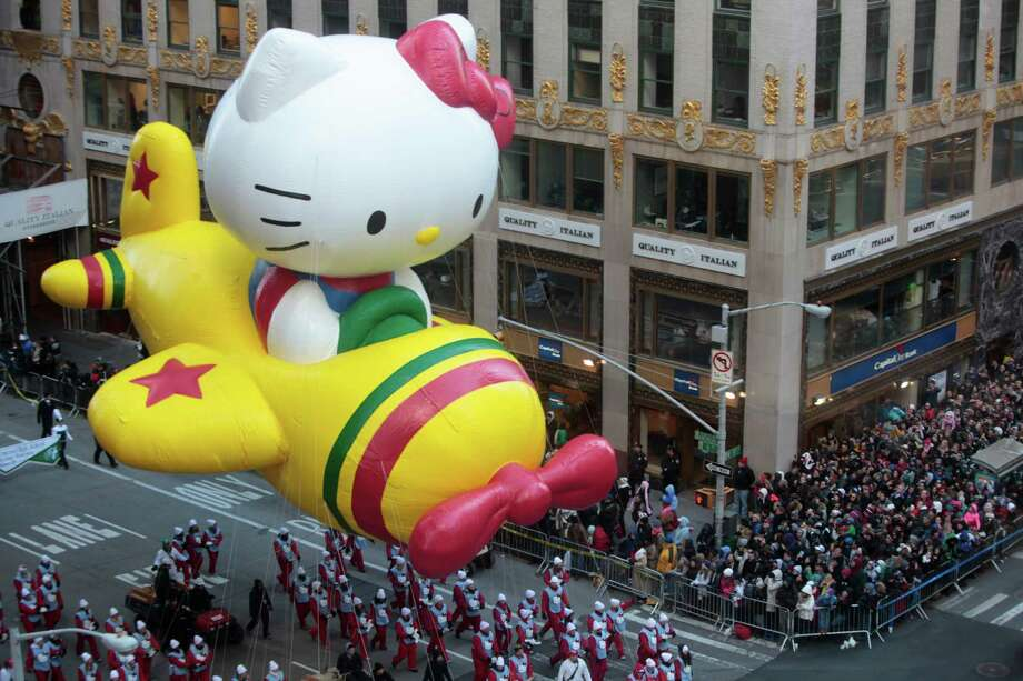 A Hello Kitty balloon in the MacyOs Thanksgiving Day Parade in New York, Nov. 28, 2013. Despite fears that unusually high winds would force their grounding, the giant balloons of the parade were making their annual march Thursday.  (Steve Berman/ The New York Times) ORG XMIT: XNYT28 Photo: STEVE BERMAN / NYTNS
