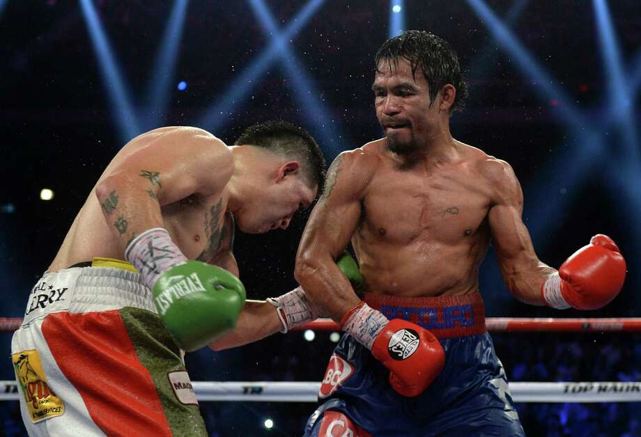 Manny Pacquiao (right) was dominant against Brandon Rios in Macau last weekend but failed to deliver a knockout. Photo: Dale De La Rey / Getty Images