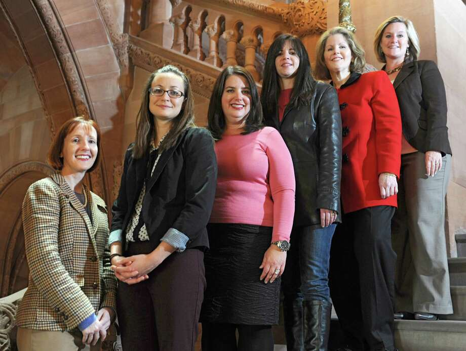 From left, Junior League of Troy members Kathleen Lisson, Heather Silvernail, Caroline Melkonian, Maura Przybylek, Lynn Vance and Kyle Belokopitsky stand on stairs inside the Capitol on Tuesday, Nov. 19, 2013 in Albany, N.Y.  (Lori Van Buren / Times Union) Photo: Lori Van Buren / 00024631A