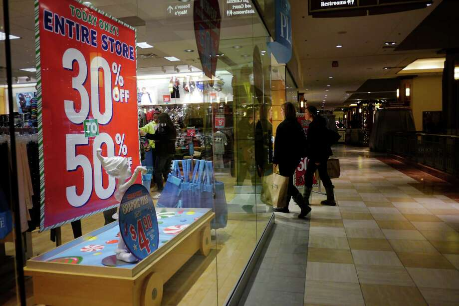 Shoppers make their way into The Children's Place store at Colonie Center Mall on Thursday evening, Nov. 28, 2013 in Albany, NY.   (Paul Buckowski / Times Union) Photo: PAUL BUCKOWSKI / 00024800A