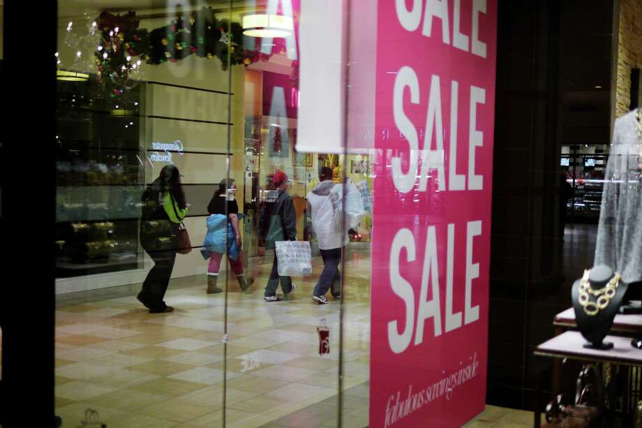Shoppers make their way through Colonie Center Mall on Thursday evening, Nov. 28, 2013 in Albany, NY.   (Paul Buckowski / Times Union) Photo: PAUL BUCKOWSKI / 00024800A
