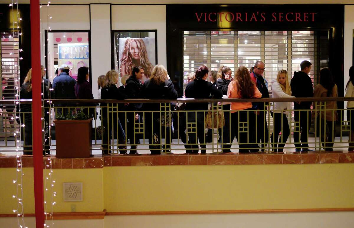 Shoppers line up outside the Victoria's Secret store at Colonie Center Mall on Thursday evening, Nov. 28, 2013 in Albany, NY. (Paul Buckowski / Times Union)