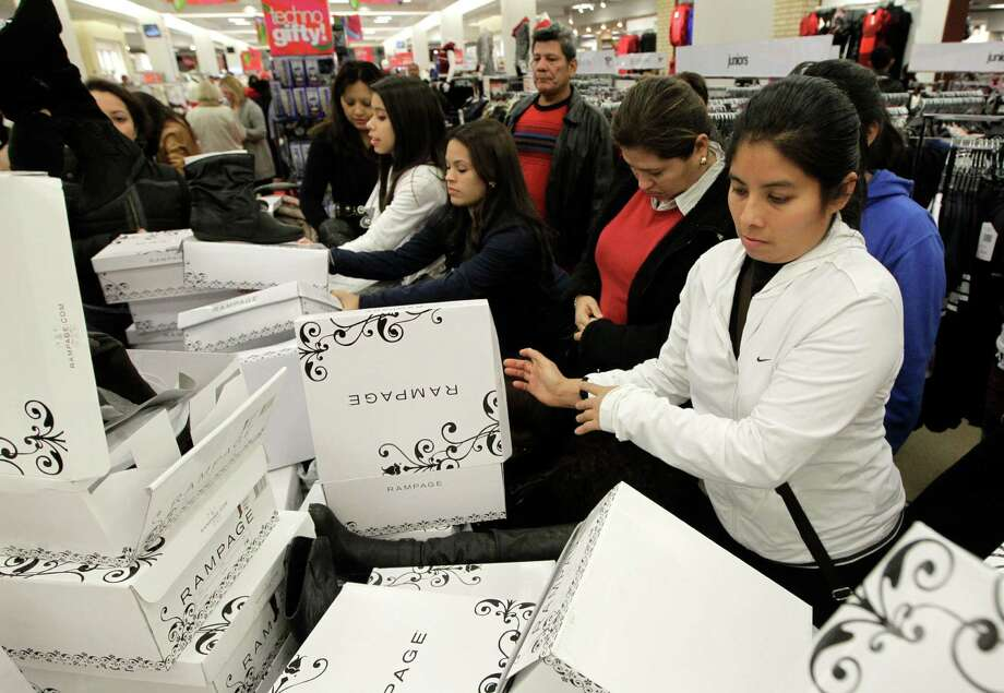 Shoppers go through shoes at the Meyerland shopping center at Palais Royal on Thursday, Nov. 28, 2013, in Houston. Photo: J. Patric Schneider, For The Chronicle / © 2013 Houston Chronicle