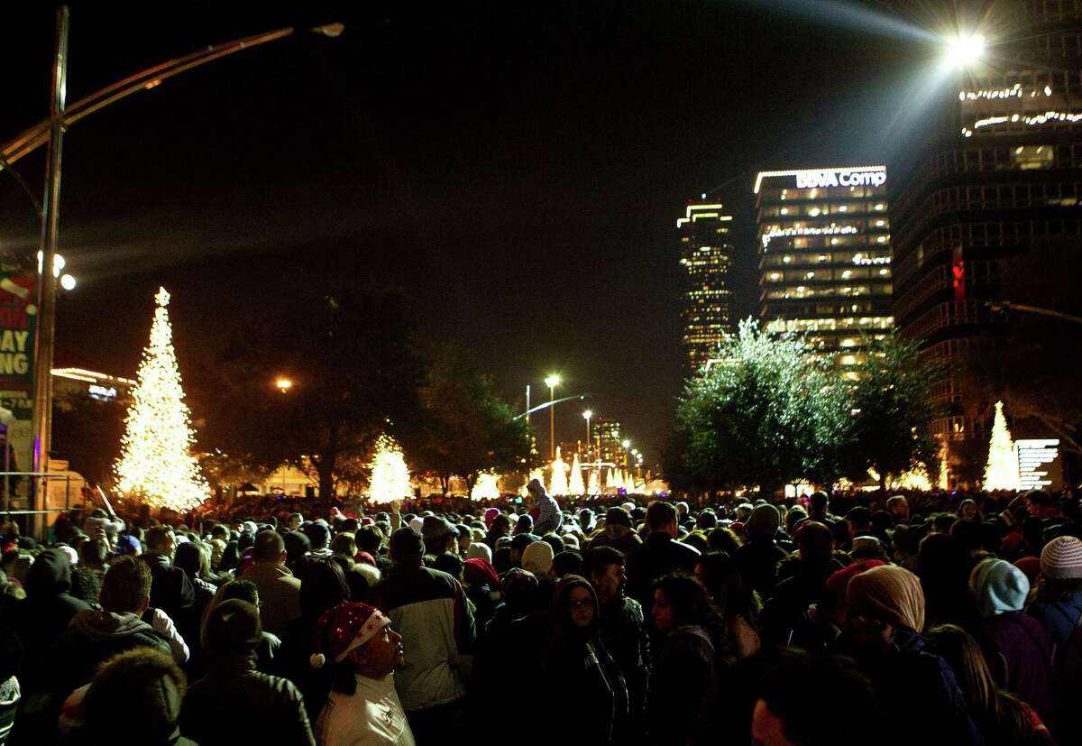 Thousands gathered to celebrate the start of the holiday season during the 28th Annual Uptown Houston Holiday Lighting on the 2000 block of Post Oak Boulevard Thursday, Nov. 28, 2013, in Houston. More than a half-million lights on 80 trees were lit on the tree-lined street along with festively lit balconies, buildings and rooftops. The evening event featured holiday music, performances, a fireworks display and a visit from Santa.
