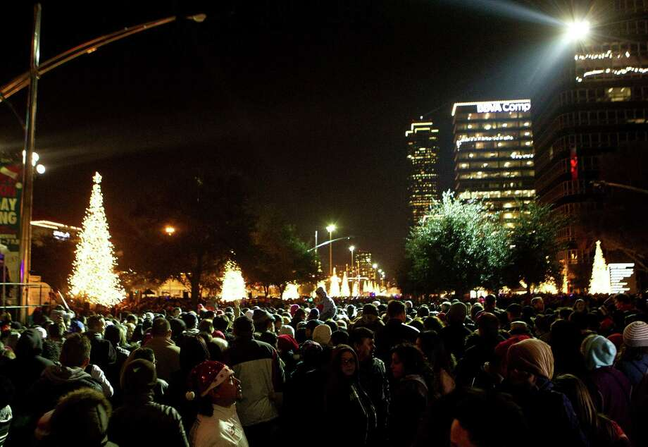 Thousands gathered to celebrate the start of the holiday season during the 28th Annual Uptown Houston Holiday Lighting on the 2000 block of Post Oak Boulevard Thursday, Nov. 28, 2013, in Houston. 