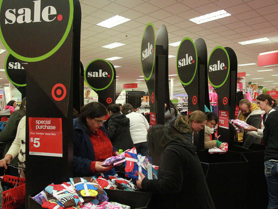 Shoppers look for products at the Target store on Bandera Road near Loop 1604 Thursday Thanksgiving November 28, 2013. Photo: JOHN DAVENPORT, San Antonio Express-News / ©San Antonio Express-News/Photo may be sold to the public