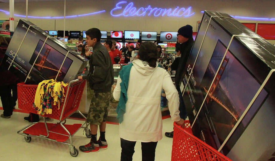 Flat screen TVs are a very popular item at the Target store on Bandera road on Gray Thursday 2013. Photo: JOHN DAVENPORT, San Antonio Express-News / ©San Antonio Express-News/Photo may be sold to the public