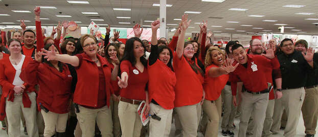 Target employees get psyched up before the doors open at the store on Bandera road store near Loop 1605 on Gray Thursday 2013. Photo: JOHN DAVENPORT, San Antonio Express-News / ©San Antonio Express-News/Photo may be sold to the public