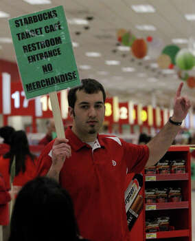 Target employee Taylor Whitt directs customers at the Target store on Bandera road near Loop 1604 on Gray Thursday 2013. Photo: JOHN DAVENPORT, San Antonio Express-News / ©San Antonio Express-News/Photo may be sold to the public