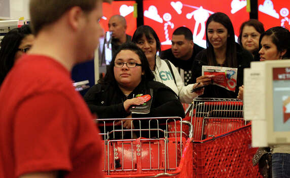 Shoppers line up to buy electronics in the Target store on Bandera road near Loop 1604 on Gray Thursday 2013. Photo: JOHN DAVENPORT, San Antonio Express-News / ©San Antonio Express-News/Photo may be sold to the public
