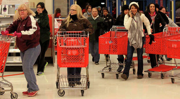 Shoppers rush into the Target store on Bandera road near Loop 1604 on Gray Thursday 2013. Photo: JOHN DAVENPORT, San Antonio Express-News / ©San Antonio Express-News/Photo may be sold to the public