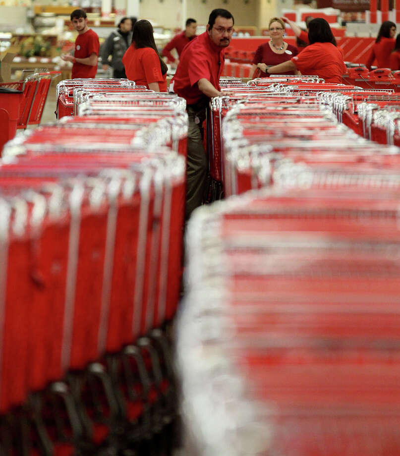 Target Logistics Manager Oscar Hernandez (center) pushes a long line of shopping carts at the Target store on Bandera Road near Loop 1604 Thursday November 28, 2013 before shoppers rush in on Gray Thursday. Photo: JOHN DAVENPORT, San Antonio Express-News / ©San Antonio Express-News/Photo may be sold to the public